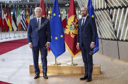 Stock Image of Montenegro's Prime Minister Dusko Markovic, left, and European Council President Charles Michel pose for the media before their meeting at the Europa building in Brussels