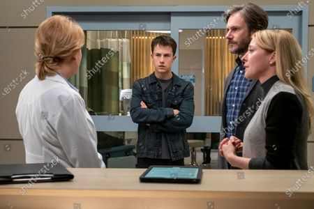Stock Image of Dylan Minnette as Clay Jensen, Josh Hamilton as Mr. Jensen and Amy Hargreaves as Mrs. Lainie Jensen