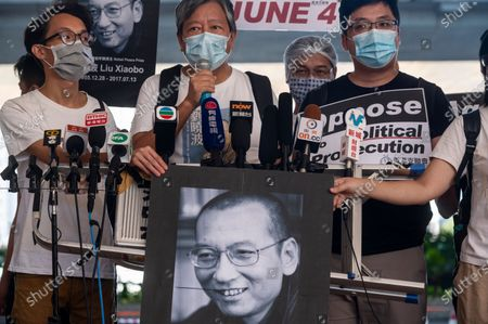 Stock Photo of Hong Kong politician and social activist Lee Cheuk-yan speaks to a press among other activists as they hold images of Chinese dissident and Nobel Peace Prize recipient Liu Xiaobo after attending a mention at the West Kowloon Magistrates Court. 13 activists who led the 2020´s Tiananmen Square crackdown candlelight vigil on June 4th appeared in court and they were charged for holding an unauthorized gathering.