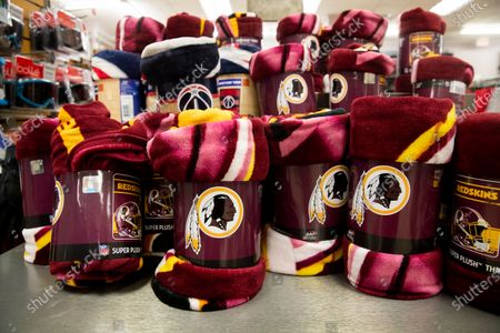 Washington Redskins blankets for sale at a store in Arlington, Virginia, USA, 13 July 2020. The National Football League's Washington Redskins will change the Redskins name and logo, the team announced in a statement on 13 July 2020. The new name has not been announced. The Redskins name has been criticized as an offensive ethnic slur.