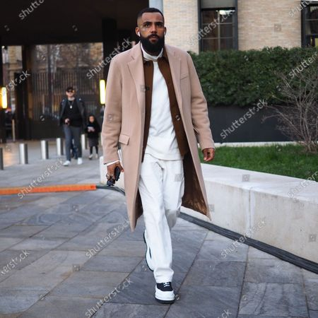 Stock Picture of MILANO, Italy: 11 January 2020: Fashion bloggers street style outfits before Neil Barrett fashion show during Milano Fashion Week man 2020