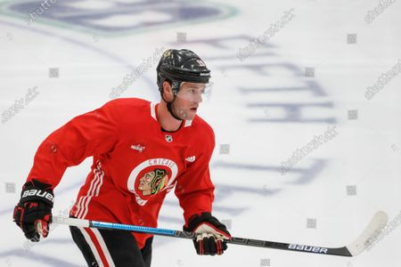 Chicago Blackhawks center Jonathan Toews skates during NHL hockey practice at Fifth Third Arena, in Chicago