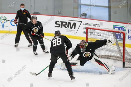 Chicago Blackhawks goaltender Malcolm Subban, right, defends against right wing Patrick Kane, center, during NHL hockey practice at Fifth Third Arena, in Chicago