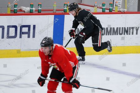Chicago Blackhawks right wing Patrick Kane, right, skates during NHL hockey practice at Fifth Third Arena, in Chicago