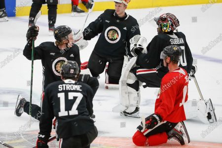 Chicago Blackhawks right wing Patrick Kane, left, talks with goaltender Malcolm Subban, right, during NHL hockey practice at Fifth Third Arena, in Chicago