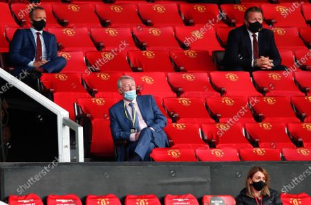 Sir Alex Ferguson, centre, watches the English Premier League soccer match between Manchester United and Southampton at Old Trafford in Manchester, England
