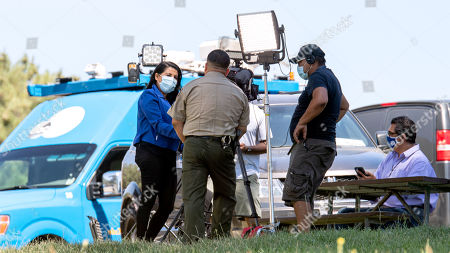 Ventura County Sheriffs talk with press after the body was found