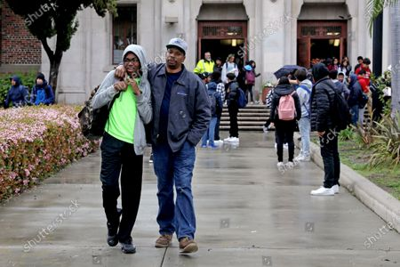 Blake Anderson, left, a freshman, walks with his father Oree Anderson, as school is let out at Hamilton High School in Los Angeles, Calif., on March 13, 2020. The school has 2,623 students who live in 94 different zip codes, some of whom travel upwards of 30 miles to school on 24 different school bus routes. 221 school staff live in 88 zip codes. Los Angeles Unified School District Superintendent Austin Beutner announced that schools will be closed due to the coronavirus. (Gary Coronado / Los Angeles Times)