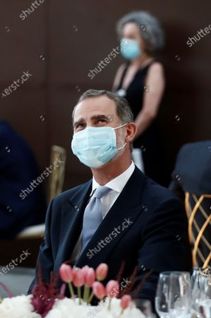 Spain's King Felipe V wears a face mask as he and his wife chair the Mariano de Cavia, Luca de Tena and Mingote Awards gala in Madrid, Spain, 13 July 2020. Writers and journalists Maruja Torres and Arturo Perez-Reverte and photographer Dani Duch will be awarded during the ceremony.