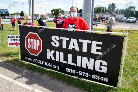Protesters against the death penalty gather in Terre Haute, Ind., . Daniel Lewis Lee, a convicted killer, was scheduled to be executed at 4 p.m. in the federal prison in Terre Haute. He was convicted in Arkansas of the 1996 killings of gun dealer William Mueller, his wife, Nancy, and her 8-year-old daughter, Sarah Powell