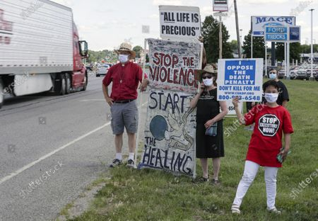 Stock Photo of Protesters against the death penalty gather in Terre Haute, Ind., . Daniel Lewis Lee, a convicted killer, was scheduled to be executed at 4 p.m. in the federal prison in Terre Haute. He was convicted in Arkansas of the 1996 killings of gun dealer William Mueller, his wife, Nancy, and her 8-year-old daughter, Sarah Powell