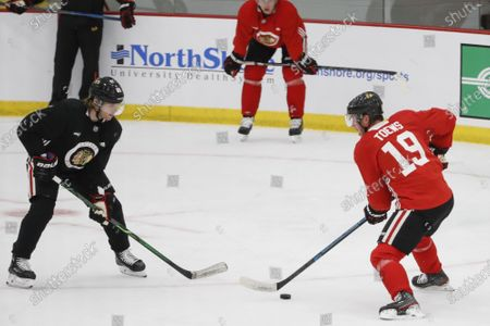 Stock Picture of Chicago Blackhawks center Jonathan Toews, right, tries to go past right wing Patrick Kane, left, during NHL hockey practice at Fifth Third Arena, in Chicago