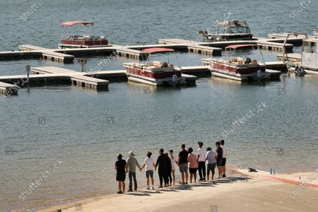 """Editorial photo of Cast members from the show """"Glee"""" and friends gathered Monday morning at the boat launch as Ventura County Sheriff's Search and Rescue dive team located a body Monday morning in Lake Piru as the search continued for actress Naya Rivera after her 4-year-old"""