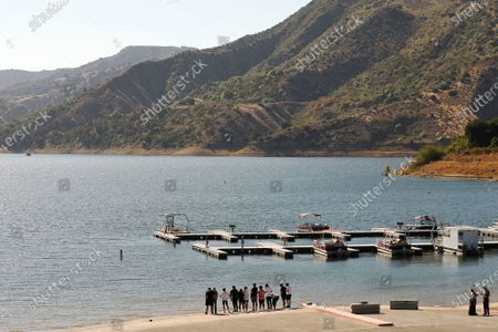 """Stock Image of Cast members, including Heather Morris, from the TV Show """"Glee"""" and friends held hands as they shouted """"Say her name - Naya"""" as they gathered on the Lake Piru boat launch Monday morning just as Ventura County Sheriff's Search and Rescue dive team located a body Monday morning in Lake Piru as the search continued for 33-year-old """"Glee"""" actress Naya Rivera after her 4-year-old son was found alone on a boat she rented last Wednesday. Rivera rented the pontoon boat and had been swimming with her son who was the last one to see her before she went missing. The boy got back into the boat after a swim but his mother did not follow. Lake Piru on Monday"""