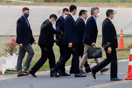 Horacio Cartes (C- without masks) and Mauricio Macri (2-R), flanked by private guards of former Paraguayan President arrive to a private hangar in the city of Luque, Paraguay, 13 July 2020. Former President of Argentina Mauricio Macri, left Asuncion on Monday after meeting former President Horacio Cartes (2013-2018) and President Mario Abdo Benitez, on a visit of less than 24 hours as the country's borders still closed due to the health quarantine.