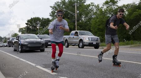 Editorial image of Rollerblading men from Massachusetts to Michigan fundraiser for the American Cancer Society, Auburn, USA - 13 Jul 2020