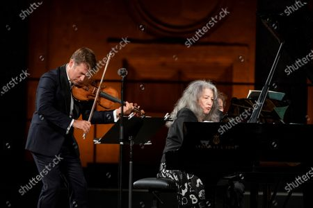 French violinist Renaud Capucon (L) and argentinian pianist Martha Argerich perfoms on stage, today 13 July, during 69 th Granada Music and Dance Festival celebrated at Carlos 5th palace in Granada, Spain.