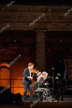 Stock Image of French violinist Renaud Capucon (L) and argentinian pianist Martha Argerich perfoms on stage, today 13 July, during 69 th Granada Music and Dance Festival celebrated at Carlos 5th palace in Granada, Spain.