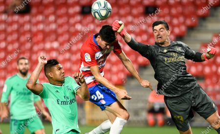 Real Madrid players Carlos Henrique Casimiro and Granada CF player Carlos Fernandez are seen in action during the La Liga Santander match between Granada CF and Real Madrid. (Final score; Granada CF 1:2 Real Madrid)