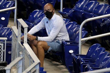 Miami Marlins CEO Derek Jeter watches baseball practice at Marlins Park in Miami