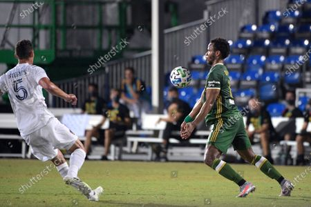Stock Picture of Portland Timbers forward Jeremy Ebobisse, right, controls a pass in front of LA Galaxy defender Daniel Steres (5) during the first half of an MLS soccer match, in Kissimmee, Fla