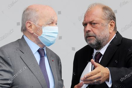Stock Photo of Former French Ombudsman (Defenseur des droits) Jacques Toubon (L) speaks with French Justice Minister Eric Dupond-Moretti at the end of the annual Bastille Day military ceremony on the Place de la Concorde in Paris, France, 14 July 2020. Bastille Day, the French National Day, is held annually on 14 July to commemorate the storming of the Bastille fortress in 1789. This year Germany, Austria, Switzerland and Luxembourg, which took in French COVID-19 patients, are special guests of honor.