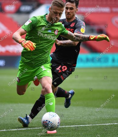 Ashton Gate Stadium, Bristol, England; Lee Gregory of Stoke City competes for the ball with Daniel Bentley of Bristol City; English Football League Championship Football, Bristol City versus Stoke City.