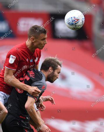 Ashton Gate Stadium, Bristol, England; Filip Benkovic of Bristol City competes in the air with Nick Powell of Stoke City; English Football League Championship Football, Bristol City versus Stoke City.