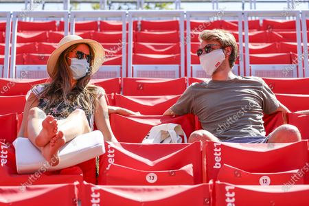 Spectators wearing protective face masks during the semi finals of the bett1ACES tennis tournament held at the Steffi-Graf-Stadium in Berlin, Germany, 14 July 2020. The tournament will be held under strict hygiene restrictions made to cope with the spread of the Coronavirus SARS-CoV-2 which causes the COVID-19 disease.