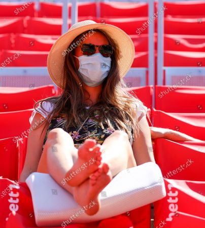 Spectator wearing a protective face mask during the semi finals of the bett1ACES tennis tournament held at the Steffi-Graf-Stadium in Berlin, Germany, 14 July 2020. The tournament will be held under strict hygiene restrictions made to cope with the spread of the Coronavirus SARS-CoV-2 which causes the COVID-19 disease.