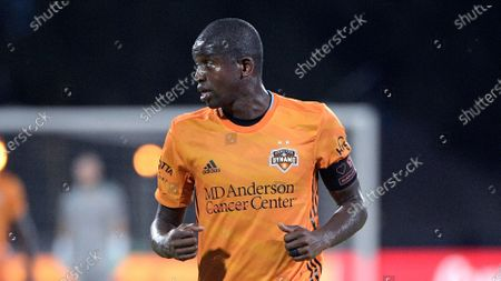 Houston Dynamo midfielder Oscar Garcia (27) sets up for a play during the first half of an MLS soccer match against the Los Angeles FC, in Kissimmee, Fla