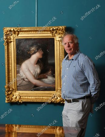 Charlie Wallrock with the painting at Wick Antiques in Lymington.  A lost portrait of Admiral Lord Nelson's mistress Lady Hamilton has been unearthed in an antiques shop.   The painting by Richard Westall shows Emma Hamilton gazing over her left shoulder, with her right breast exposed from under a loose gown.  It is thought to have been painted in 1802, three years before Nelson's death at the Battle of Trafalgar while defeating the combined French and Spanish fleets.  The painting in oil on canvas and mounted in a gold frame was taken to antique dealer in Lymington, Hants, by an eldelry woman who had owned it for years. It is now for sale for £85,000.