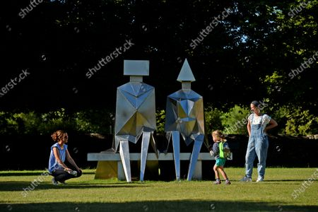 A family admires a sculpture called, 'Sitting Couple on Bench' by Lynn Chadwick  An art exhibition that took three years to plan only to be postponed on the eve of its opening due to COVID-19 has finally been revealed to the public.  The Spirit and Endeavour exhibition at Salisbury Cathedral is being held to mark the historic building's 800th anniversary.  The event brings together work by some of the most influential artists of the 20th and 21st centuries, including Antony Gormley, Henry Moore, Grayson Perry and Mark Wallinger.  The cathedral also commissioned two new artworks - Time and Place by Bruce Munro and Somewhere in the Universe by Daniel Chadwick.  After the event had to be put on hold in March, a virtual version of the exhibition was launched and attracted 14,000 online visitors.