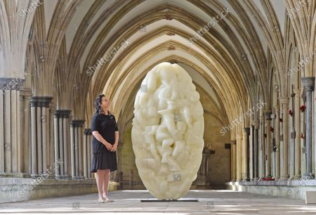 Exhibition curator, Jacquiline Creswell a sculpture entitled, 'Sail' by Tony Cragg.  An art exhibition that took three years to plan only to be postponed on the eve of its opening due to COVID-19 has finally been revealed to the public.  The Spirit and Endeavour exhibition at Salisbury Cathedral is being held to mark the historic building's 800th anniversary.  The event brings together work by some of the most influential artists of the 20th and 21st centuries, including Antony Gormley, Henry Moore, Grayson Perry and Mark Wallinger.  The cathedral also commissioned two new artworks - Time and Place by Bruce Munro and Somewhere in the Universe by Daniel Chadwick.  After the event had to be put on hold in March, a virtual version of the exhibition was launched and attracted 14,000 online visitors.