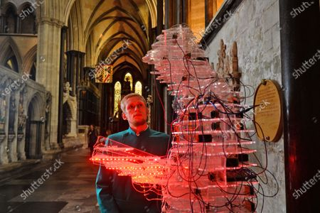 Verger, Tyler Ringwood-Hoare admires the reader by Stanza   An art exhibition that took three years to plan only to be postponed on the eve of its opening due to COVID-19 has finally been revealed to the public.  The Spirit and Endeavour exhibition at Salisbury Cathedral is being held to mark the historic building's 800th anniversary.  The event brings together work by some of the most influential artists of the 20th and 21st centuries, including Antony Gormley, Henry Moore, Grayson Perry and Mark Wallinger.  The cathedral also commissioned two new artworks - Time and Place by Bruce Munro and Somewhere in the Universe by Daniel Chadwick.  After the event had to be put on hold in March, a virtual version of the exhibition was launched and attracted 14,000 online visitors.