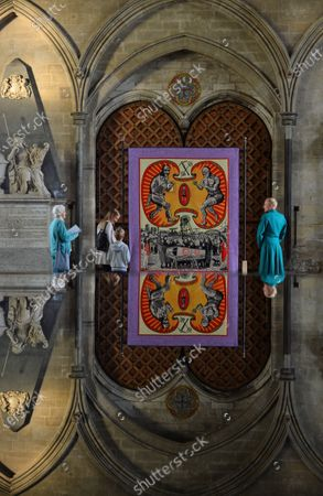 Visitors reflected in the Cathedral font admire a Tapestry by Grayson Perry called, 'Death of a Working Hero'  An art exhibition that took three years to plan only to be postponed on the eve of its opening due to COVID-19 has finally been revealed to the public.  The Spirit and Endeavour exhibition at Salisbury Cathedral is being held to mark the historic building's 800th anniversary.  The event brings together work by some of the most influential artists of the 20th and 21st centuries, including Antony Gormley, Henry Moore, Grayson Perry and Mark Wallinger.  The cathedral also commissioned two new artworks - Time and Place by Bruce Munro and Somewhere in the Universe by Daniel Chadwick.  After the event had to be put on hold in March, a virtual version of the exhibition was launched and attracted 14,000 online visitors.