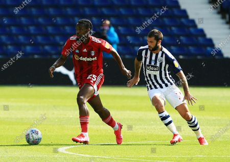 Josh Onomah of Fulham and Charlie Austin of West Bromwich Albion