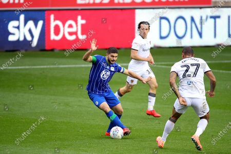 Sam Morsy of Wigan Athletic with SKY BET branding on pitch side LED boards