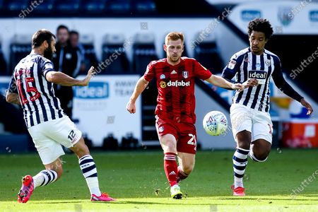 Harrison Reed of Fulham takes on Matheus Pereira and Charlie Austin of West Bromwich Albion