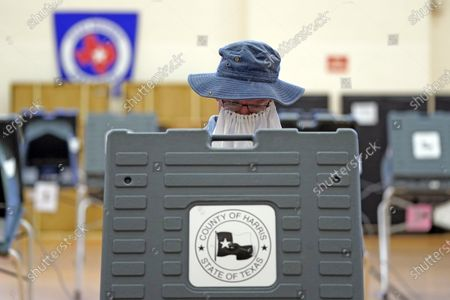 Stock Image of Peter McDonald casts his ballot, in Houston