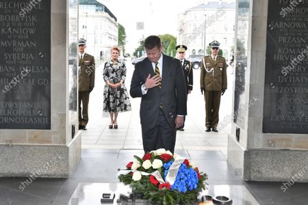 US Secretary of the Army Ryan McCarthy (C) and US Ambassador to Poland Georgette Mosbacher (2L) during the wreath laying on the Tomb of the Unknown Soldier in Warsaw, Poland, 14 July 2020. The US Secretary of the Army met with the Polish Defence Minister Mariusz Blaszczak today.