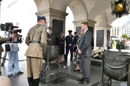 US Secretary of the Army Ryan McCarthy (C-front) and US Ambassador to Poland Georgette Mosbacher (C-back) during the wreath laying on the Tomb of the Unknown Soldier in Warsaw, Poland, 14 July 2020. The US Secretary of the Army met with the Polish Defence Minister Mariusz Blaszczak today.