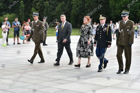 US Secretary of the Army Ryan McCarthy (2L) and US Ambassador to Poland Georgette Mosbacher (3R) during the wreath laying on the Tomb of the Unknown Soldier in Warsaw, Poland, 14 July 2020. The US Secretary of Land Forces met with the Polish Defence Minister Mariusz Blaszczak today.