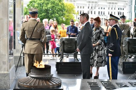 US Secretary of the Army Ryan McCarthy (3R) and US Ambassador to Poland Georgette Mosbacher (2R) during the wreath laying on the Tomb of the Unknown Soldier in Warsaw, Poland, 14 July 2020. The US Secretary of the Army met with the Polish Defence Minister Mariusz Blaszczak today.