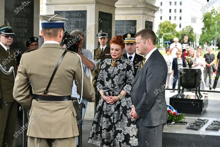 US Secretary of the Army Ryan McCarthy (R) and US Ambassador to Poland Georgette Mosbacher (L) during the wreath laying on the Tomb of the Unknown Soldier in Warsaw, Poland, 14 July 2020. The US Secretary of the Army met with the Polish Defence Minister Mariusz Blaszczak today.
