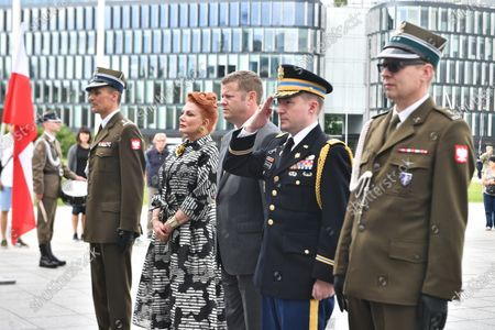 US Secretary of the Army Ryan McCarthy (3R) and US Ambassador to Poland Georgette Mosbacher (2L) during the wreath laying on the Tomb of the Unknown Soldier in Warsaw, Poland, 14 July 2020. The US Secretary of the Army met with the Polish Defence Minister Mariusz Blaszczak today.