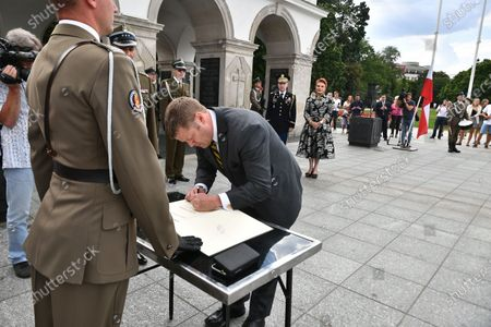 US Secretary of the Army Ryan McCarthy (R) during an entry in the diary book after laying a wreath on the Tomb of the Unknown Soldier in Warsaw, Poland, 14 July 2020. The US Secretary of the Army met with the Polish Defence Minister Mariusz Blaszczak today.
