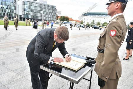 Stock Image of US Secretary of the Army Ryan McCarthy (L) during an entry in the diary book after laying a wreath on the Tomb of the Unknown Soldier in Warsaw, Poland, 14 July 2020. The US Secretary of the Army met with the Polish Defence Minister Mariusz Blaszczak today.