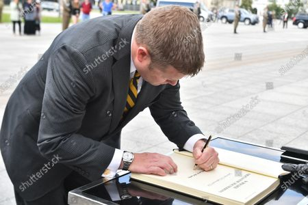 Stock Photo of US Secretary of the Army Ryan McCarthy during an entry in the diary book after laying a wreath on the Tomb of the Unknown Soldier in Warsaw, Poland, 14 July 2020. The US Secretary of the Army met with the Polish Defence Minister Mariusz Blaszczak today.