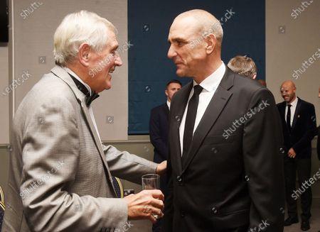 Leeds Utd former hard men Norman Hunter (L) and Vinnie Jones have a chat.